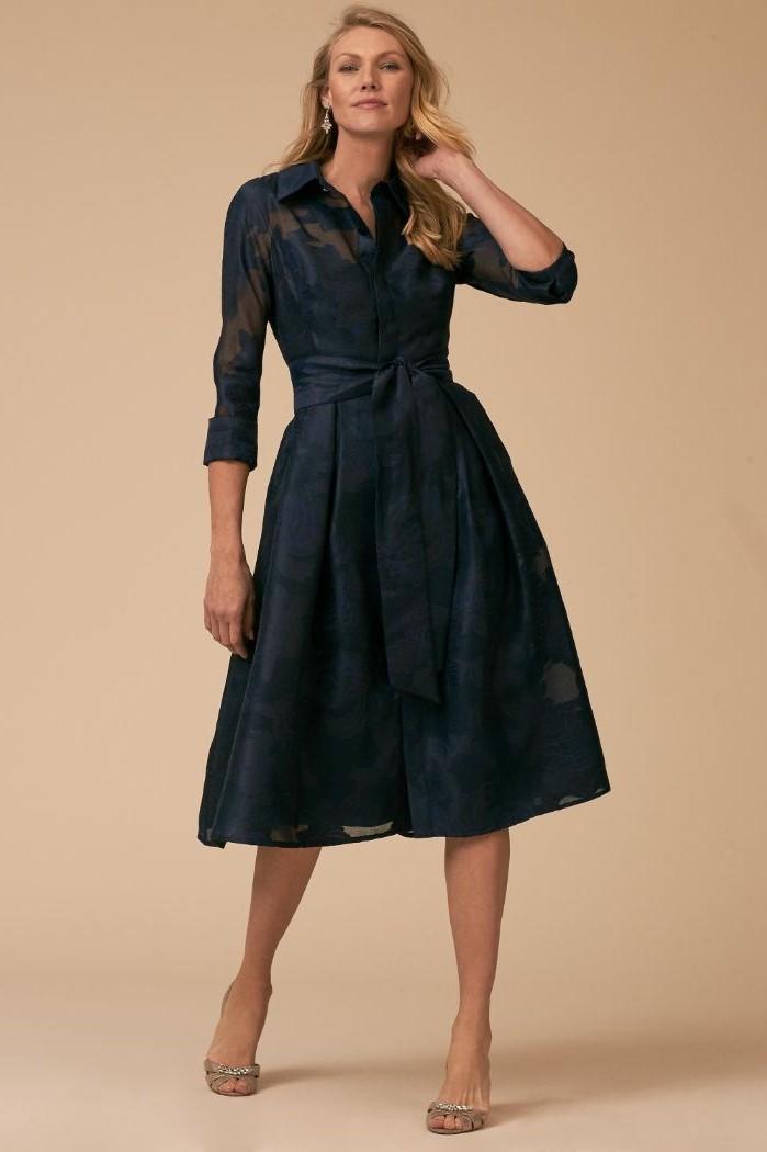 dark blue lace, below the knee dress, blonde wavy hair, silver heels, mother of the bride tea length