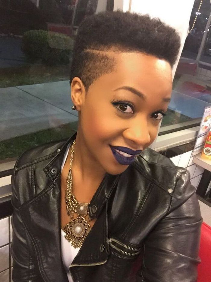 pixie cut black women, black leather jacket, purple lipstick, large necklace