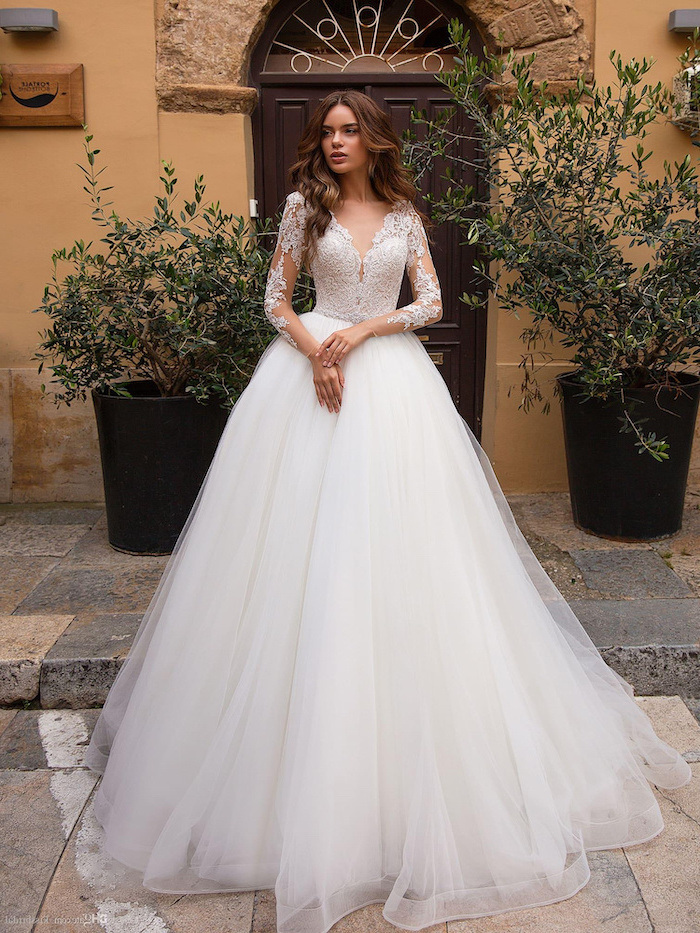 long brown wavy hair, white dress, made of tulle and lace, wedding dresses with sleeves