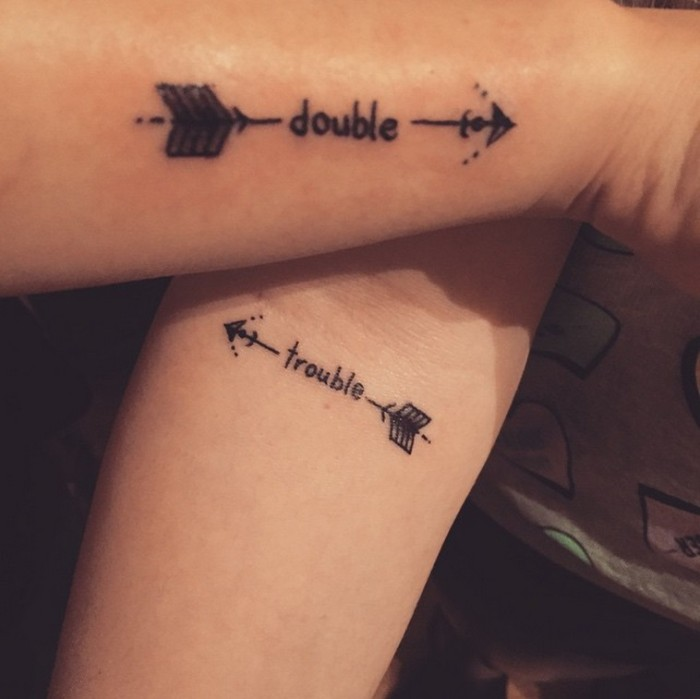double trouble, arrows on the side, matching tattoo ideas, side arm tattoo, forearm tattoo