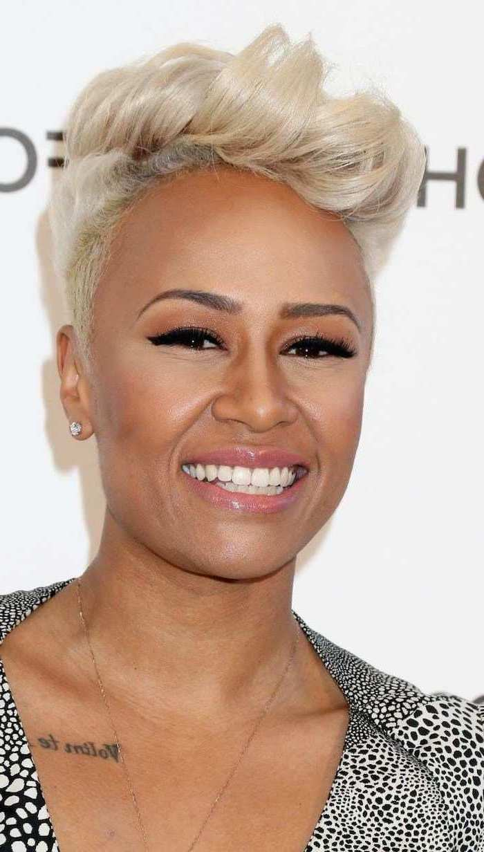 emeli sande smiling, with blonde hair, short natural hairstyles, black and white printed dress