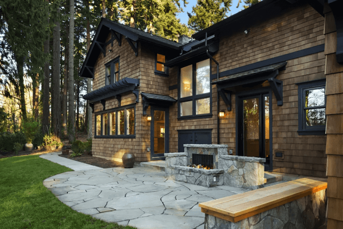 stone tiled floor and pathway, stone fireplace, wooden bench, front porch designs