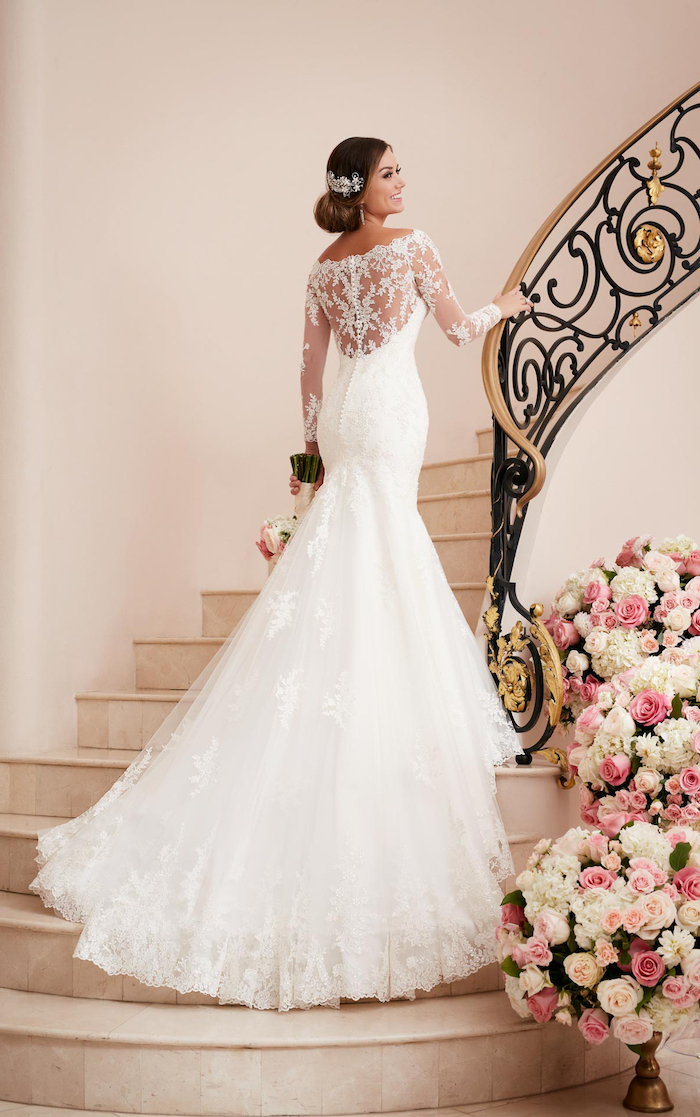 woman walking up a staircase, long white dress, made of tulle and lace, a line wedding dresses