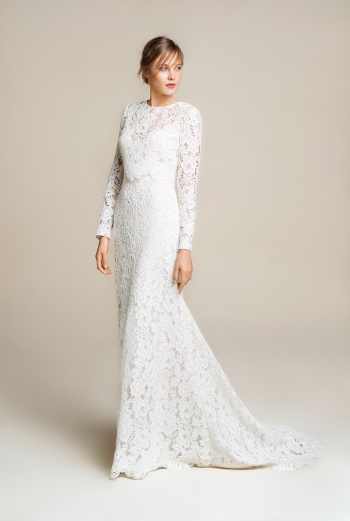 long lace dress, long sleeves, wedding dresses with long trains, blonde hair, in a low updo, with bangs