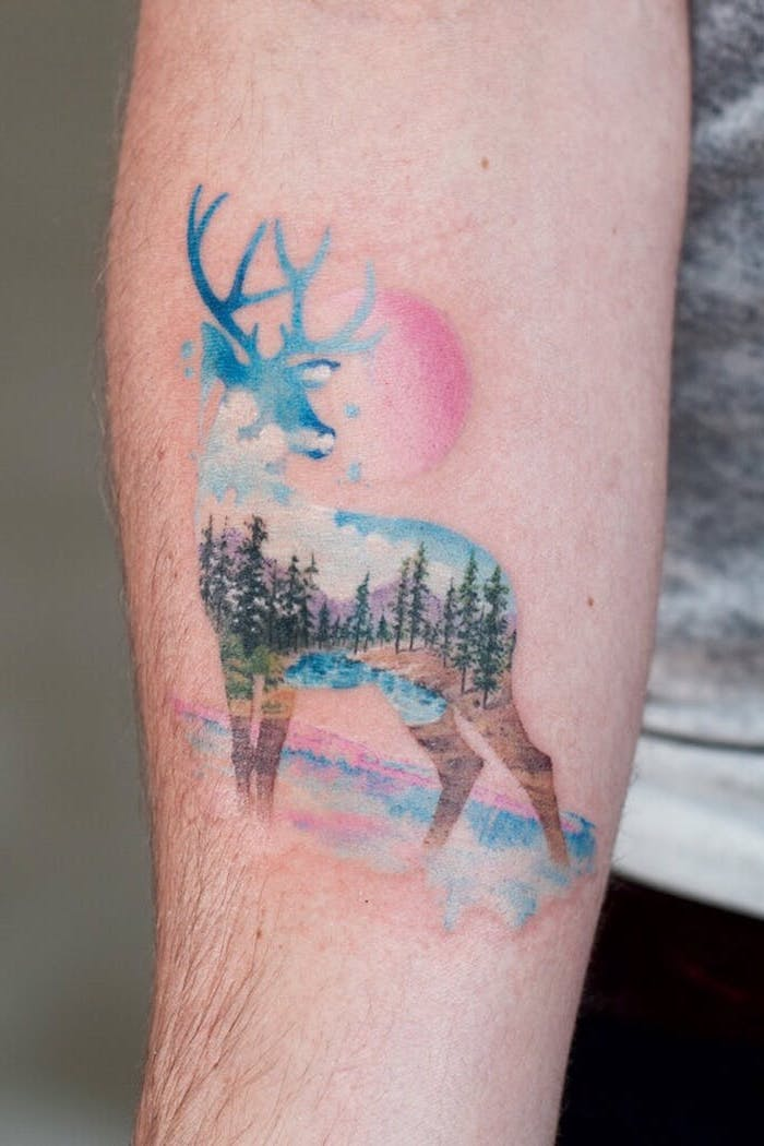 forest landscape, inside a deer, paint splatter tattoo, watercolor forearm tattoo