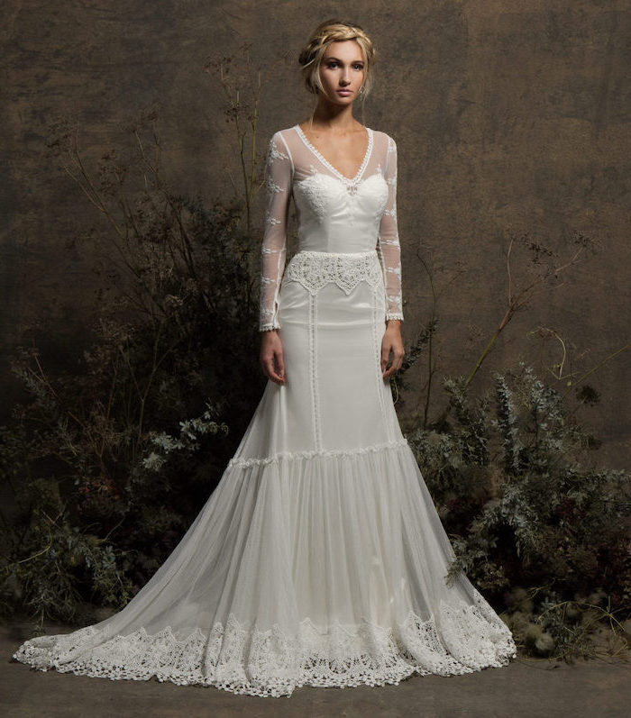 wedding dresses with long trains, blonde braided hair, in a low updo, lace dress