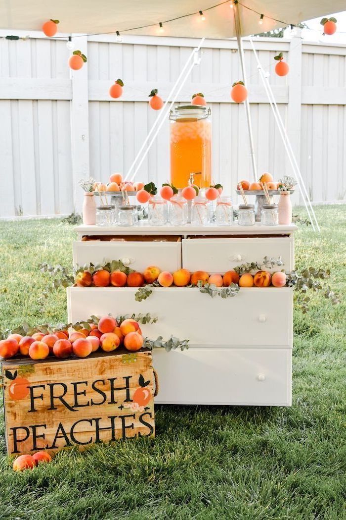 large pitcher, full of juice, fresh peaches, mason jars, themes for parties, vintage cabinet
