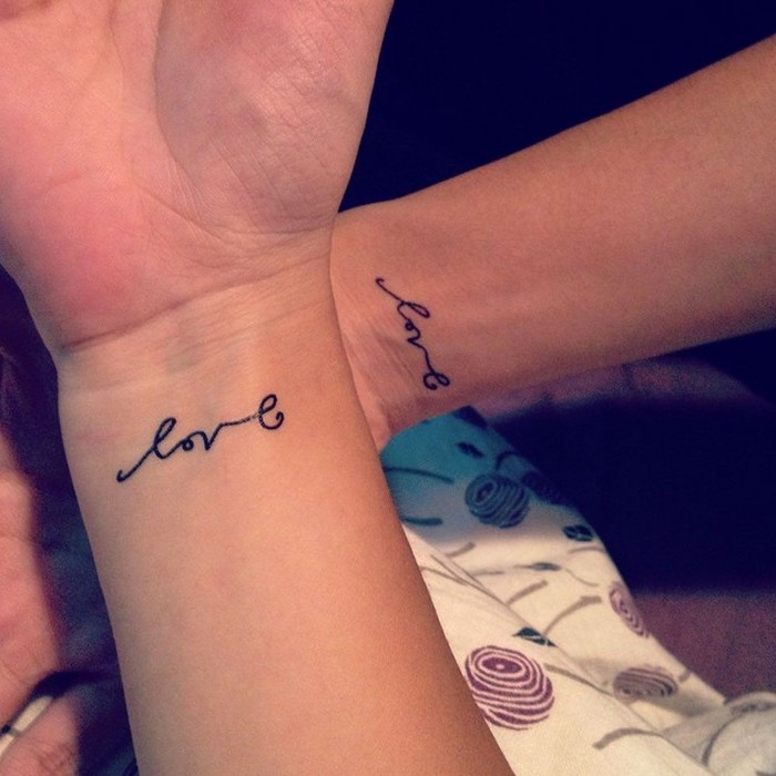 love cursive font, wrist tattoos, matching tattoo ideas, side by side arms