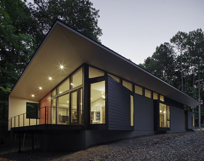 contemporary house, metal railing, front porch designs, tall windows, lights on the ceiling