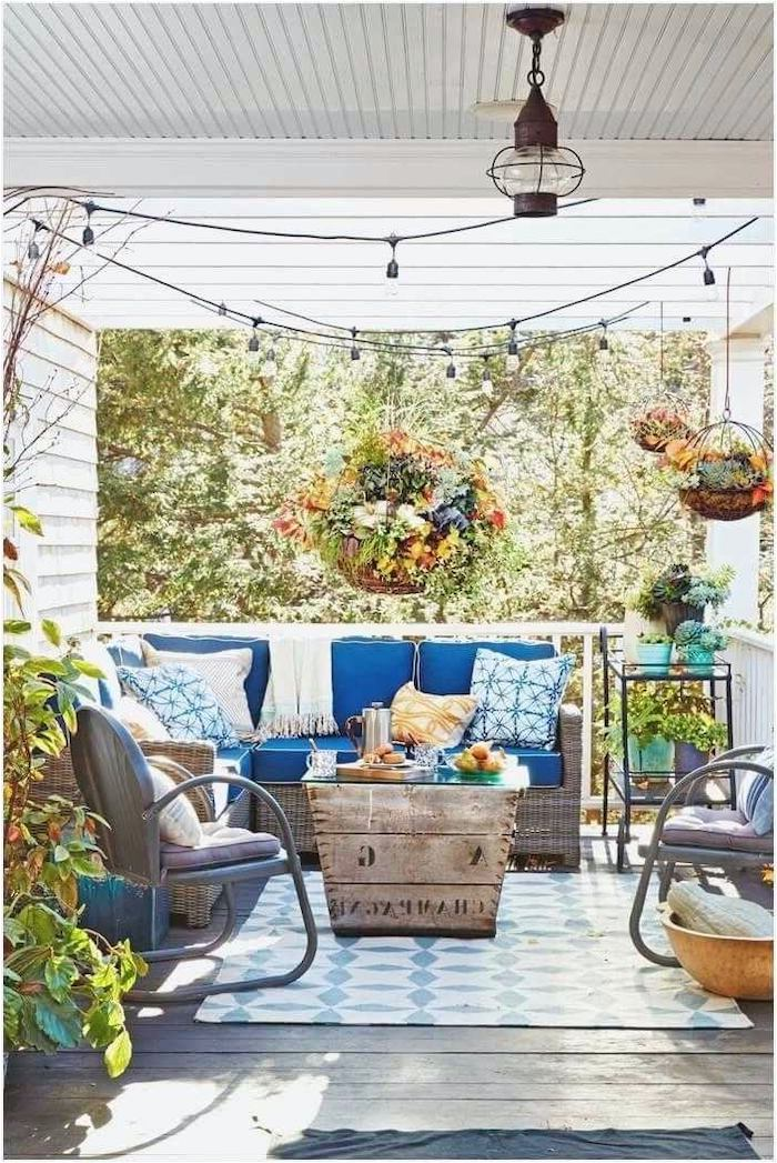 garden furniture, blue cushions, pictures of screened in porches, colourful throw pillows, hanging flowers