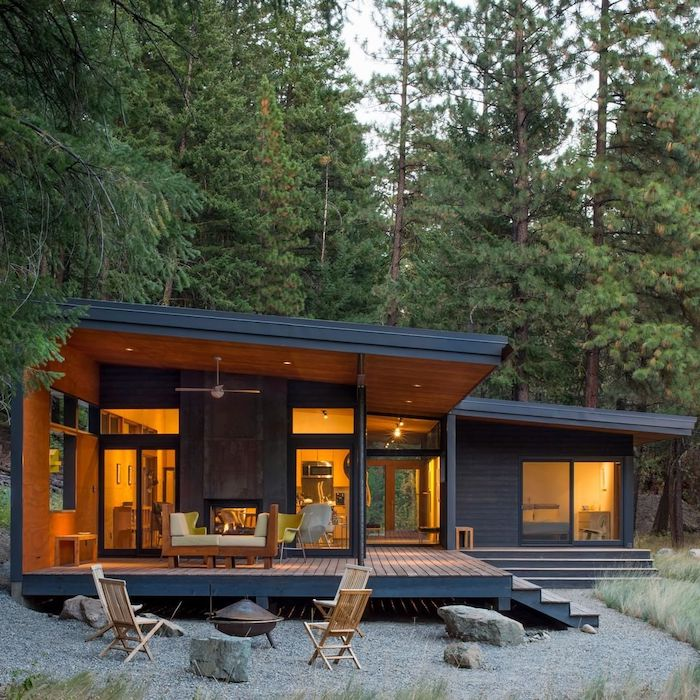 tall trees, wooden floor and furniture, white cushions, front porch designs, tall windows