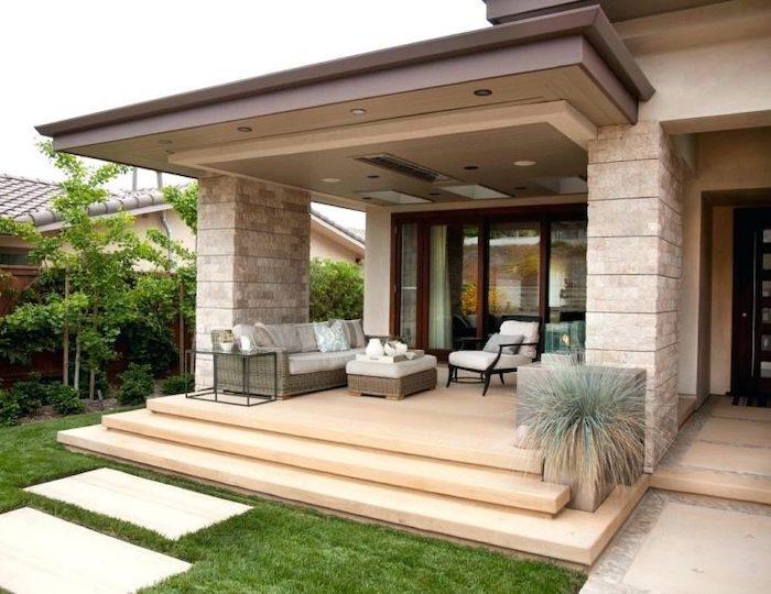 wooden garden furniture, front porch ideas, tiled pathway, brick columns, white cushions