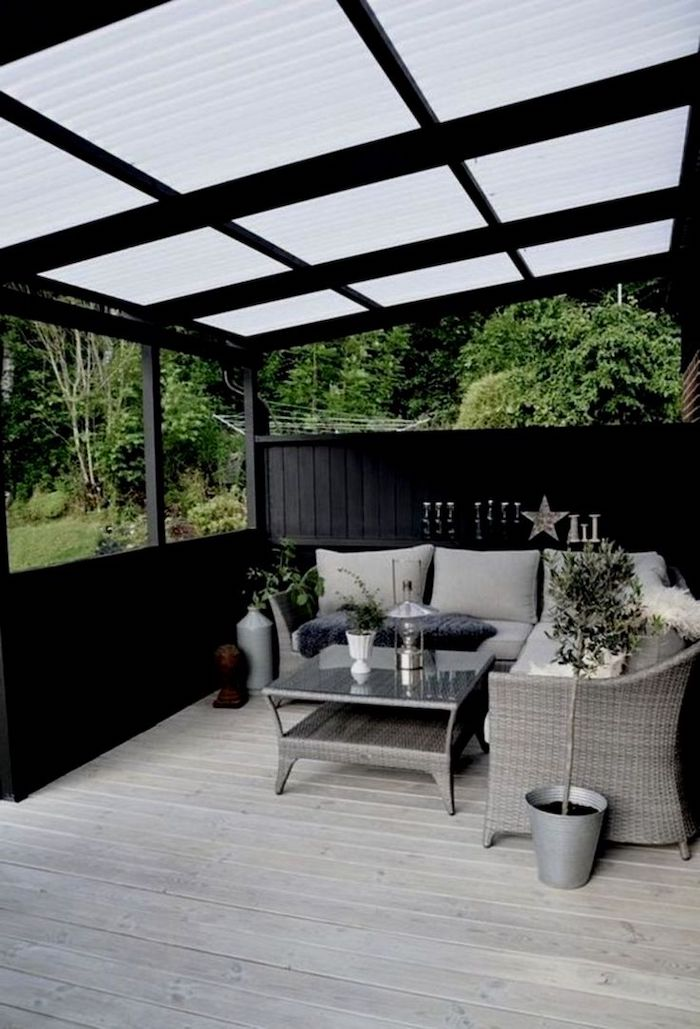 dark wooden porch, garden furniture, porch decorating ideas, grey cushions, potted plants