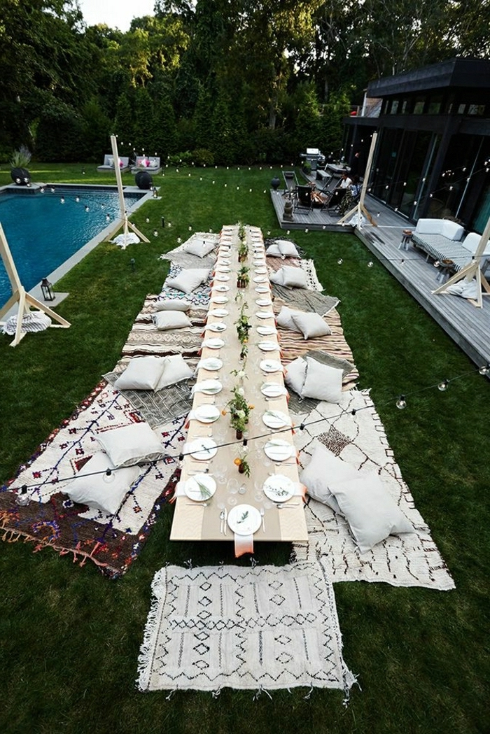 long table, garden party, themes for parties, blankets and pillows, on the grass, next to the pool