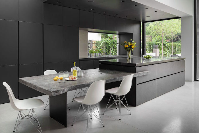 white chairs, granite countertops, black cabinets, remodeling a kitchen, flower bouquet, large windows