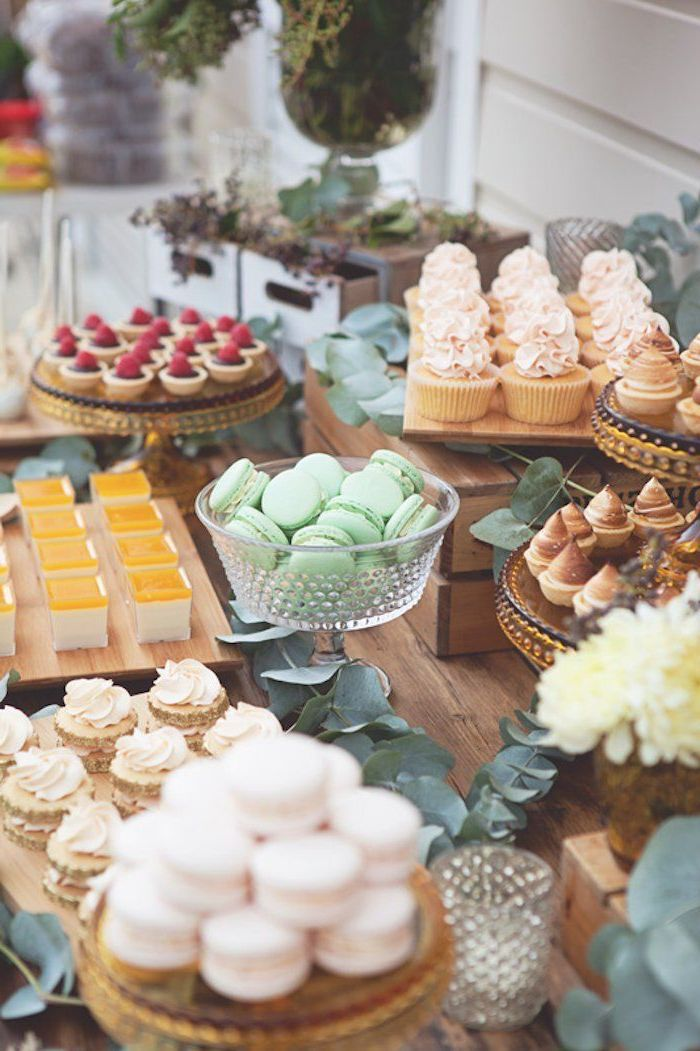 dessert table, green macaroons, fun games for teens, gold cake stands, greenery table runners