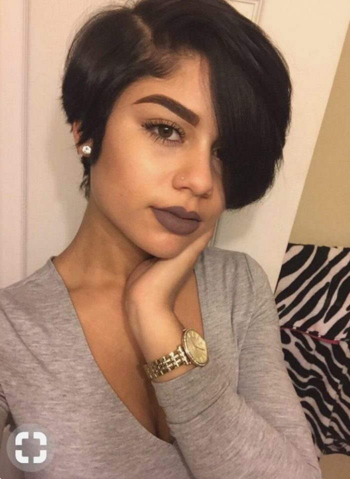 grey blouse, gold watch, pixie cut black women, dark lipstick, black hair, small earrings