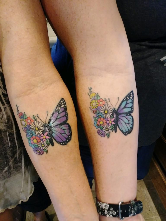 mother and daughter matching tattoos, half flowers, half butterfly, forearm tattoos