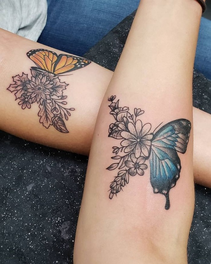 two halves of a butterfly, blue and yellow, black flowers, best friend tattoos, forearm tattoos