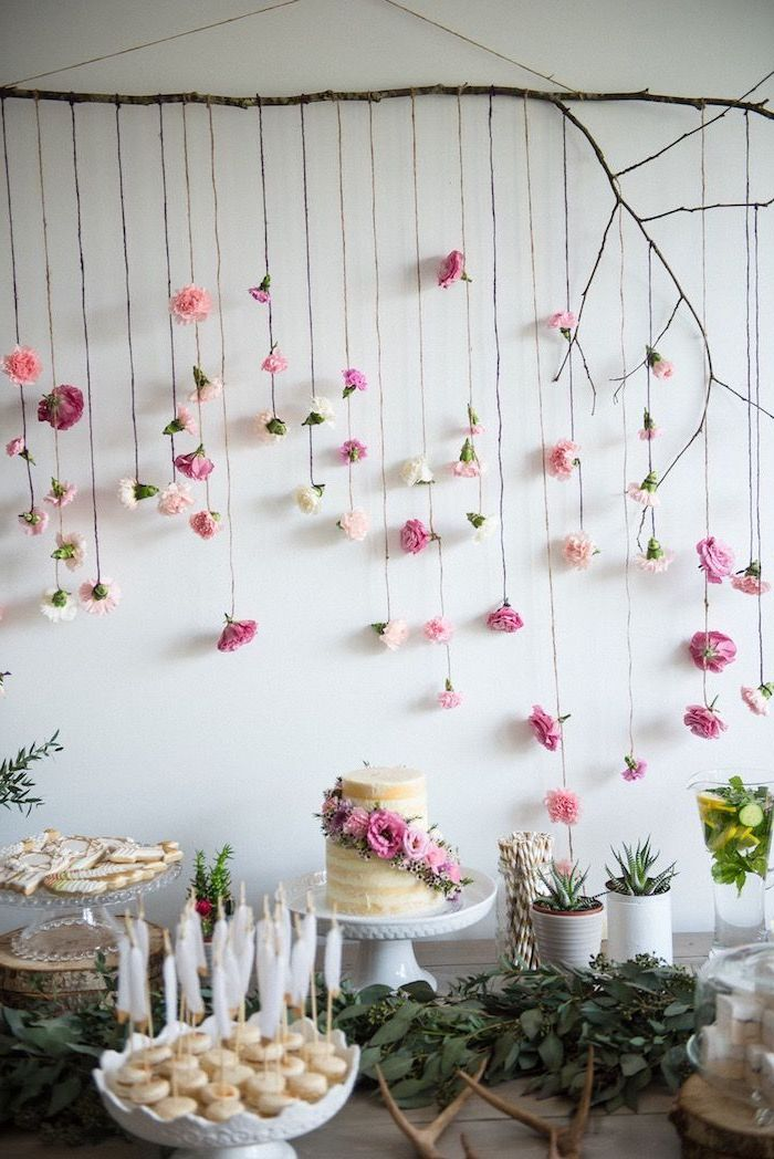 fun birthday ideas, hanging flowers, from a tree branch, white cake stands, cake pops, greenery table runner