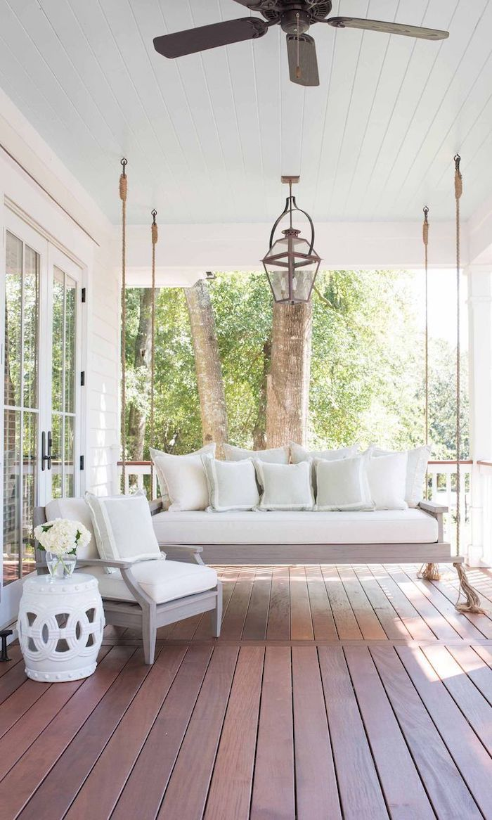 wooden swing, white cushions and throw pillows, screened in porch designs, wooden floor