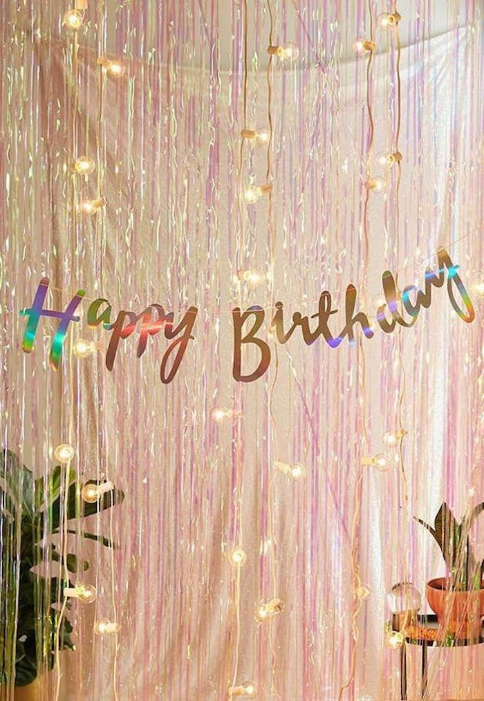 happy birthday sign, pink tassel garland, fairy lights, fun birthday ideas, potted plants