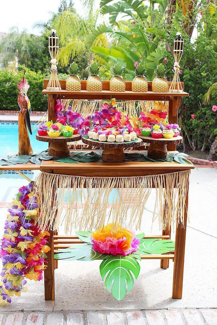 hawaiian theme, fun birthday ideas, wooden cake stands, paper pineapples, palm trees