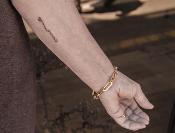 small heart, forearm tattoo, golden bracelet, grey shirt, tiny tattoos