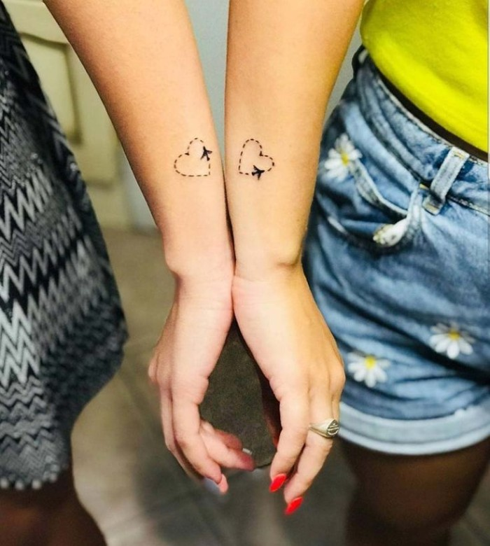 hearts and airplanes, side arm tattoos, small bestfriend tattoos, jean shorts, black and white dress