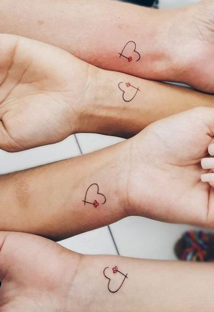 best friend tattoo ideas, hearts and flowers, four hands next to each other, wrist tattoos