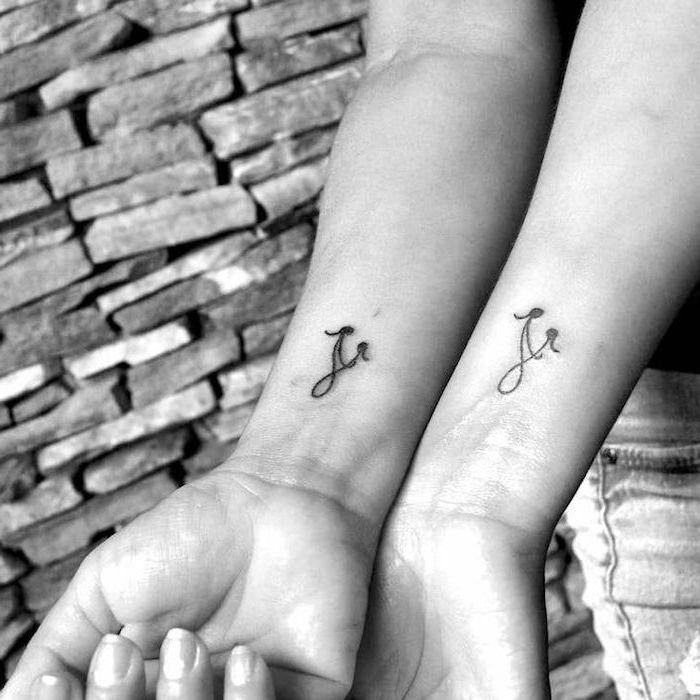 infinity symbol, mother daughter symbol, mother daughter silhouettes, wrist tattoos