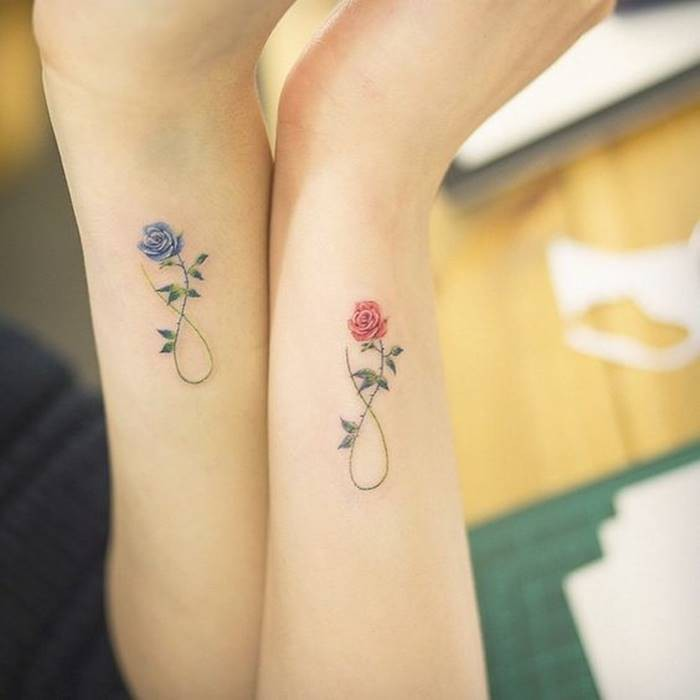 infinity symbols, made up of roses, pink and blue, best friend tattoo ideas side arm tattoos