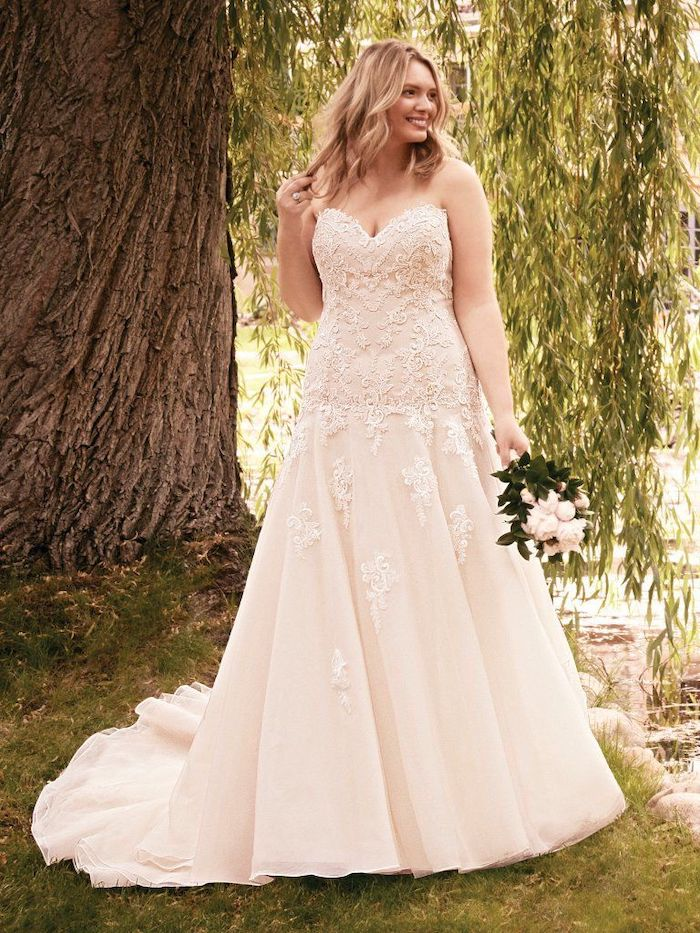 fit and flare, simple beach wedding dresses, strapless corset, flower bouquet, wavy blonde hair