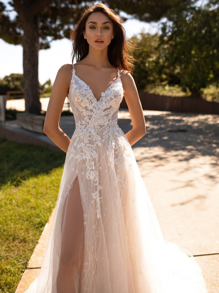 informal wedding dresses, long brown wavy hair, dress made of tulle and lace, v neckline