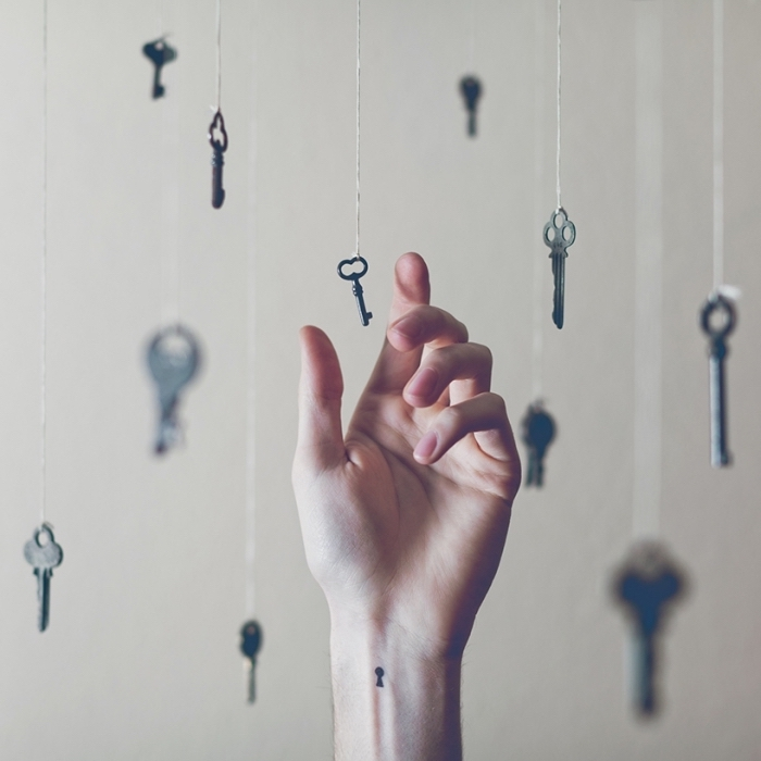 keys hanging, on white strands, tattoo placement ideas, keyhole wrist tattoo