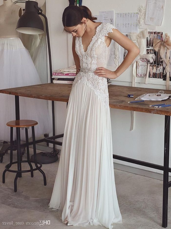 large wooden table, wedding dresses for beach wedding, made of lace, pleated chiffon