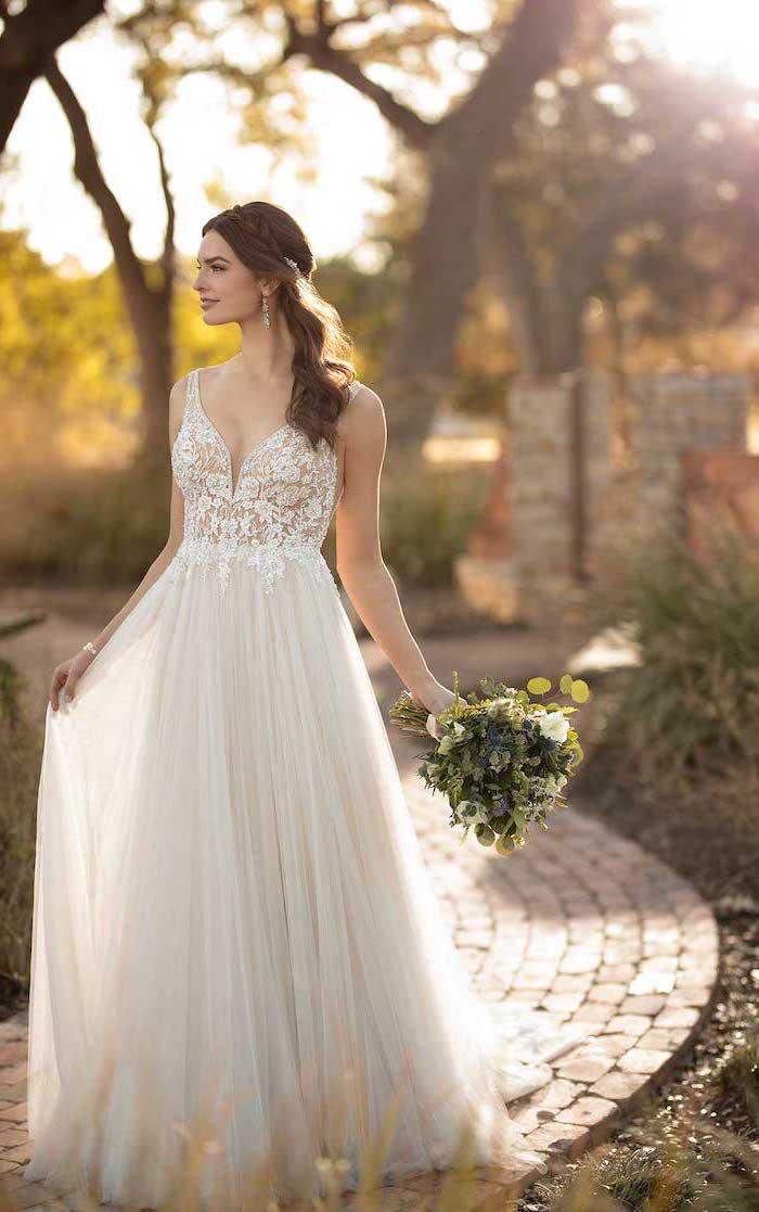beach informal wedding dresses, lace corset, chiffon skirt, braided brown hair, flower bouquet