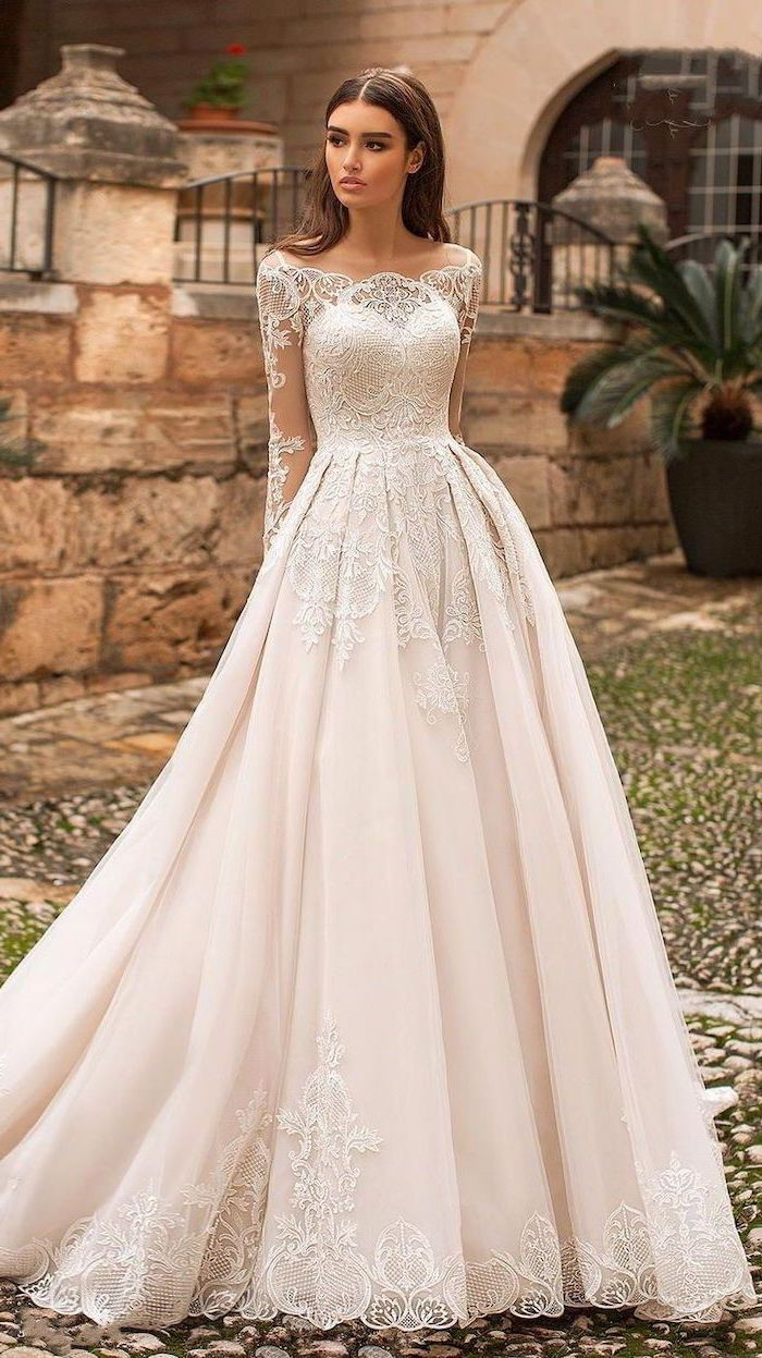ivory dress, made of tulle and lace, a line wedding dresses, long brown wavy hair