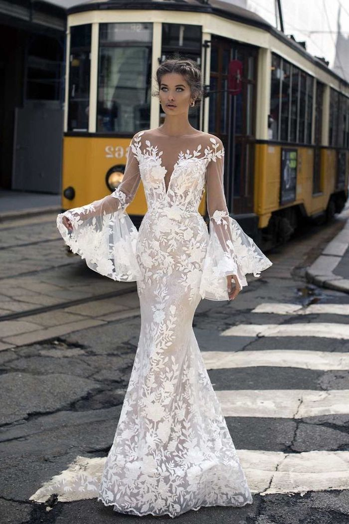 yellow tram, off shoulder, wide sleeves, long sleeve lace mermaid wedding dress, brown hair, in a low updo