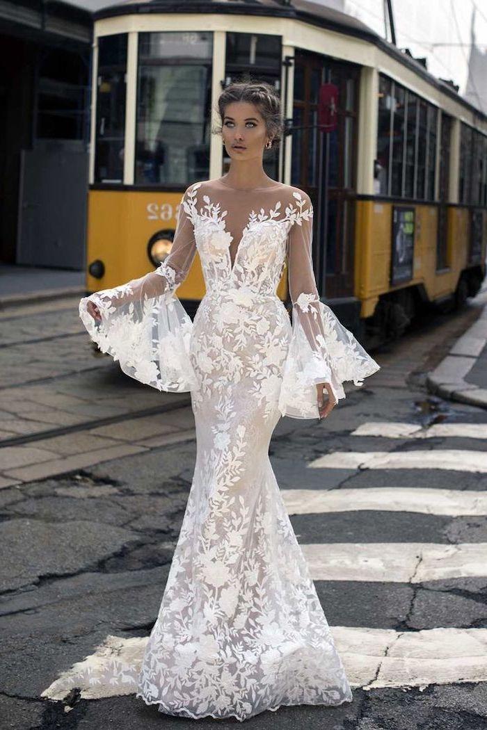 yellow tram, off shoulder, wide sleeves, long sleeve lace mermaid wedding dress, brown hair, in a low updo