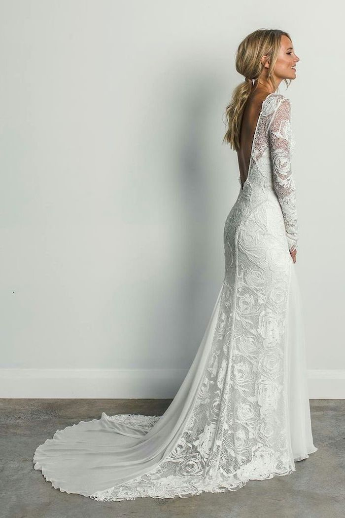 long blonde hair, in a ponytail, long train, lace dress, informal wedding dresses, open back, long sleeves
