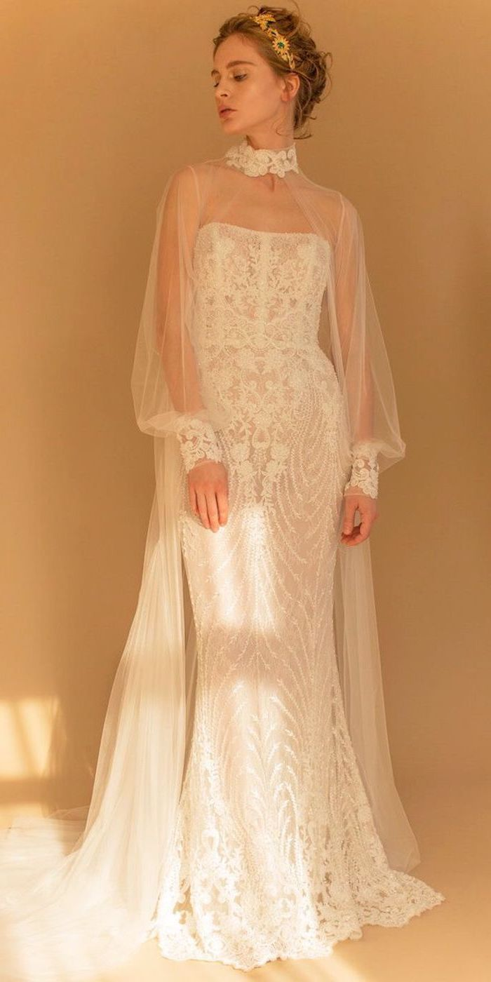 lace wedding dress with cap sleeves, high neck, blonde hair, in a low updo, hair accessory