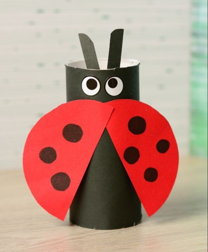 carton lady bug, made from toilet paper roll, creative things to do when bored, wooden table