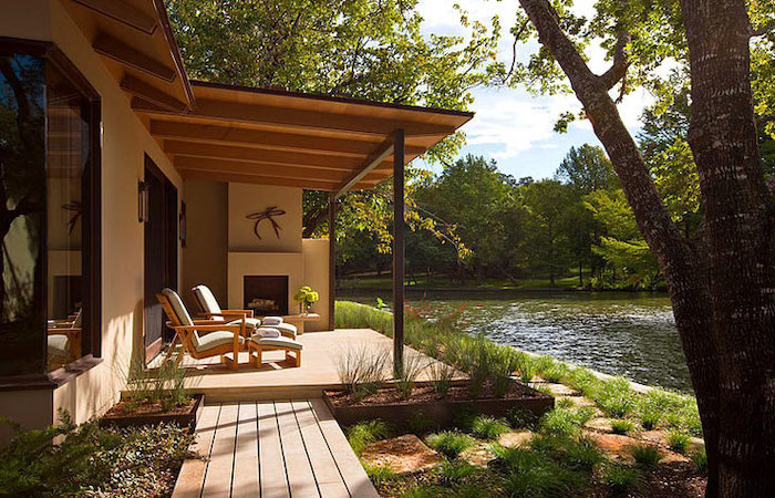 house by the lake, small front porch ideas, wooden armchairs, white cushions