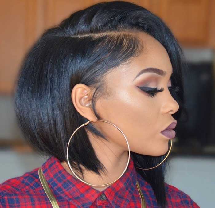 bob hairstyles for black women, black hair, large hoop earrings, purple lipstick, plaid red shirt