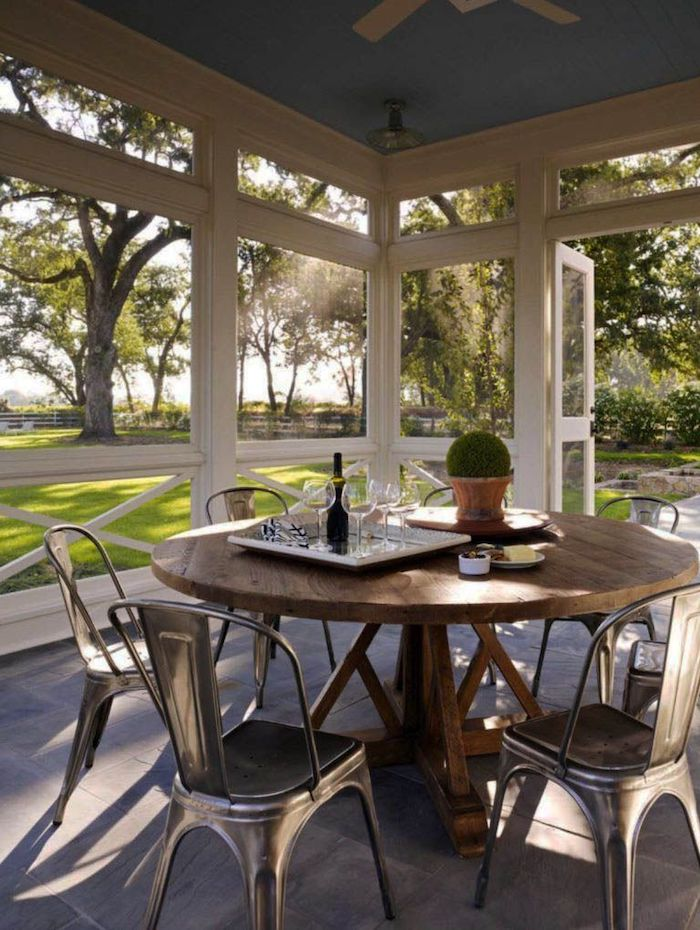 small front porch ideas, wooden table, metal chairs, screened in porch, tray with wine glasses