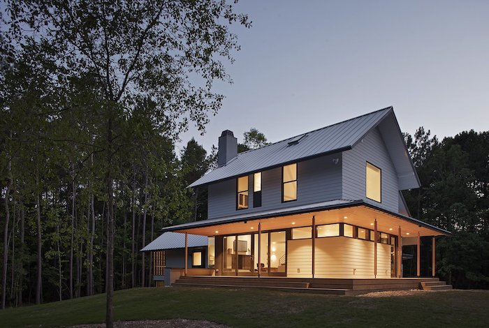 wooden house, surrounded by tall trees, small front porch ideas, lights on the ceiling