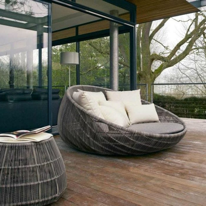 large armchair, grey cushions, white throw pillows, front door decor ideas, wooden ottoman