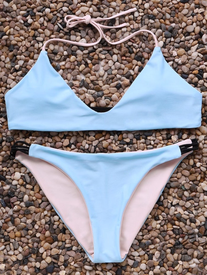 light blue, light pink, two piece, kids bathing suits, on top of rocks