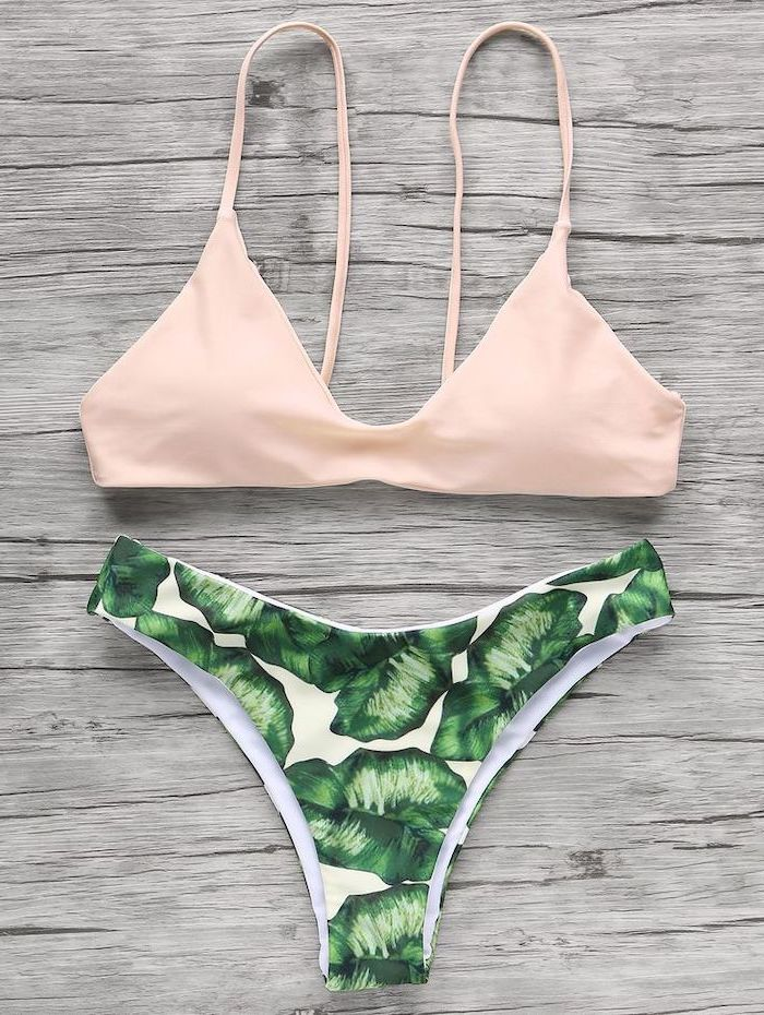 toddler mermaid swimsuit, light pink top, green leaves print, high waisted bottom, wooden background